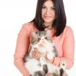 Beautiful smiling brunette girl and her big cat on a white background — Stock Photo #40586393