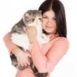 Beautiful smiling brunette girl and her big cat on a white background — Stock Photo #40586409