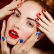 Close-up portrait of sexy european young woman model with glamour make-up and red bright manicure. christmas makeup, bloody red lips with gloss — Stock Photo #40752279