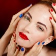 Close-up portrait of sexy european young woman model with glamour make-up and red bright manicure. christmas makeup, bloody red lips with gloss — Stock Photo #40752295