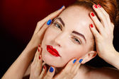 Close-up portrait of sexy european young woman model with glamour make-up and red bright manicure. christmas makeup, bloody red lips with gloss — Stock Photo
