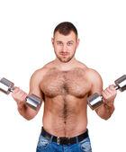 白い背景の上のダンベル体操筋肉男のクローズ アップの肖像画 — ストック写真