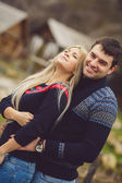 Young couple in love walking in autumn park holding hands — Стоковое фото