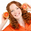 Portrait of attractive caucasian smiling woman isolated on white studio shot with oranges — Stock Photo #42887721