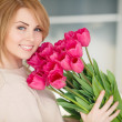 Bright pink flowers in girl's hands. — Stock Photo #43471201
