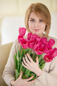 Bright pink flowers in girl's hands. — Stock Photo