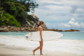Surfing beautiful woman on the beach — Stock Photo