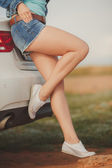 Girl with beautiful legs in car — Stock Photo