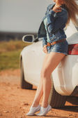 Girl with beautiful legs in car — Stock fotografie