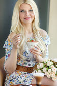 Smiling girl with dessert — Stock Photo