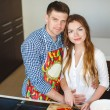 Young couple making a salad together in the kitchen — Stock Photo #47107745
