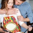 Young couple making a salad together in the kitchen — Stock Photo #47107817