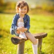 Portrait of a cute little girl on a sunny summer day — Stock Photo #47524915