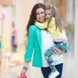 A young mother and her daughter, shopping — Stock Photo #47525017