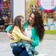 A young mother and her daughter, shopping — Stock Photo #47525023