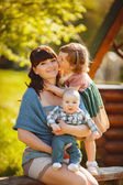 Happy family outdoors on the grass in the Park — Stock Photo