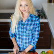 A young woman prepares fresh vegetable salad — Stock Photo #47780453