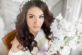 Pretty bride with bouquet — Stock Photo