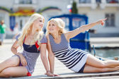 Two blonde near Yacht Club — Stock Photo