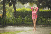Portrait of beautiful woman under the tropical rain — Stock Photo