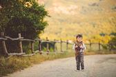 Cute happy boy on the street — Stock Photo