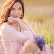 Beautiful girl on the lavender field. — Stock Photo #49046655