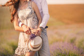 Young couple in love outdoor.Stunning sensual outdoor portrait of young stylish fashion couple posing in summer in field — Stock fotografie