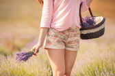 Beautiful girl on the lavender field. — Stock Photo