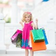Little girl fashion with packages at the Mall — Stock Photo #49125141