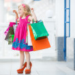 Little girl fashion with packages at the Mall — Stock Photo #49125145