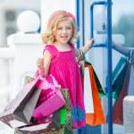 Fun preschool girl walking with bags. — Stock Photo #49125193
