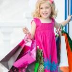 Fun preschool girl walking with bags. — Stock Photo #49125205