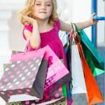 Fun preschool girl walking with bags. — Stock Photo #49125207