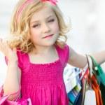 Fun preschool girl walking with bags. — Stock Photo #49125221