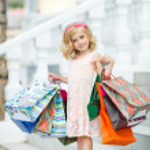 Fun preschool girl walking with bags. — Stock Photo #49125237