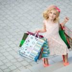 Fun preschool girl walking with bags. — Stock Photo #49125261