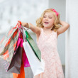 Little girl fashion with packages at the Mall. — Stock Photo #49125299