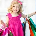 Fun preschool girl walking with bags. — Stock Photo #49125331