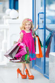 Little girl fashion with packages at the Mall — Stock Photo