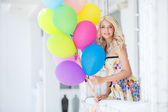 A young woman with large colourful latex balloons — Stock Photo