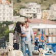 Happy family with dogs on the Quay in the summer — Stock Photo