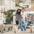 Happy family with dogs on the Quay in the summer — Stock Photo #49639295