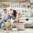Happy family with dogs on the Quay in the summer — Stock Photo #49639483