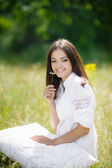 The girl with a pillow on the fresh spring grass. — Stockfoto