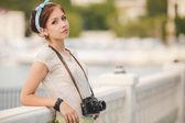 Young woman photographer portrait. Soft colors. — Stock Photo