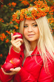 Girl in Orange wreath with Red Apple in hand — Stock Photo