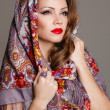 Portrait of a beautiful young woman with a scarf on her head — Stock Photo #49885263