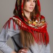 Portrait of a beautiful young woman with a scarf on her head — Stock Photo #49885335