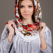 Portrait of a beautiful young woman with a scarf on her head — Stock Photo #49885405