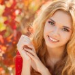 Portrait of beautiful young woman in autumn park. — Stock Photo #49884503